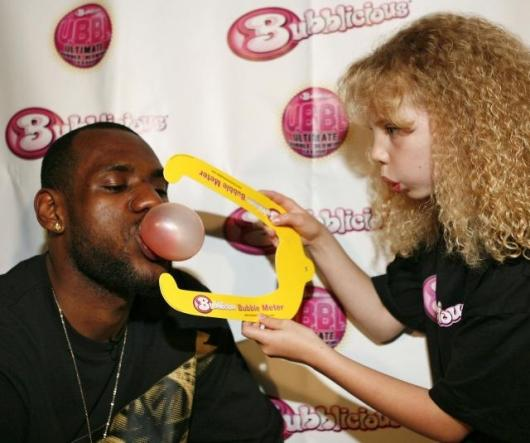Basketball star LeBron James has been appointed official U.B.B.L. commissioner. That's Lebron showing his prowess and a fan measuring the size of his bubble with a bubble meter.