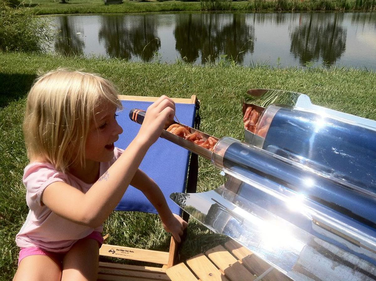 The GoSun Stove uses parabolic mirrors to concentrate sunlight onto a glass tube and cook the contents inside, allowing it to act as a portable convection oven