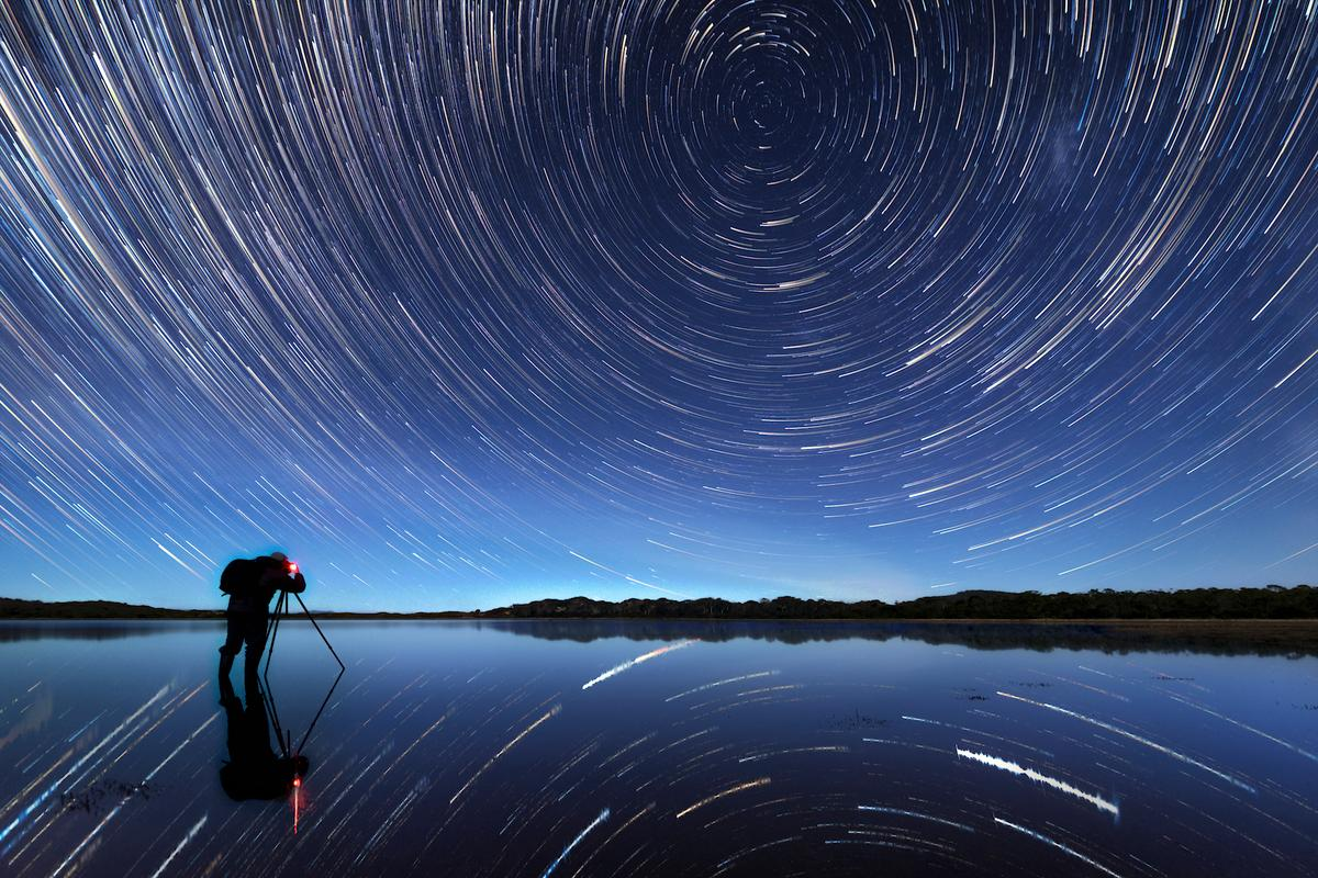 Cosmic Plughole, Highly Commended in the People And Space category. This image is a stacked star trail, combined to show an hour and a quarter of the Earth's rotation through space and time