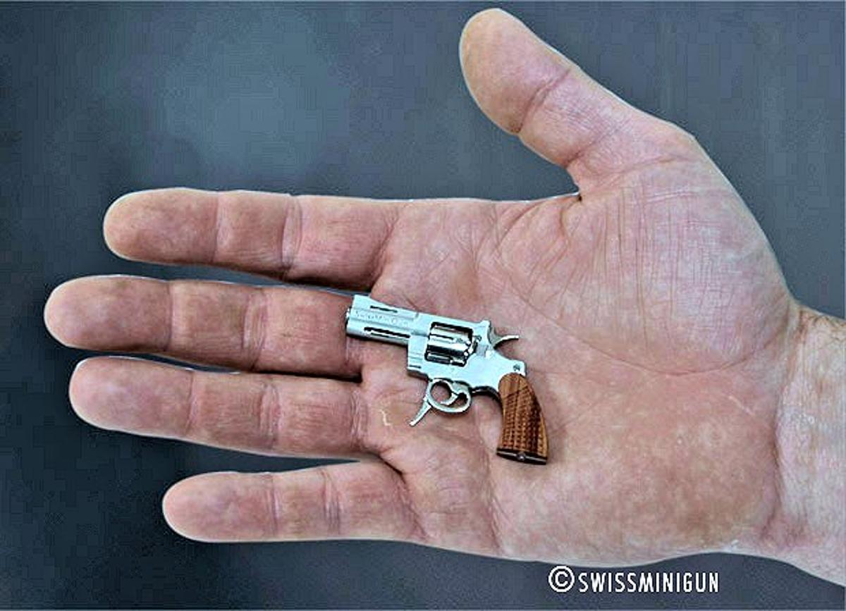 The .09 caliber (2.34 mm) SwissMiniGun is dwarfed in this man's hand (Photo: SwissMiniGun)