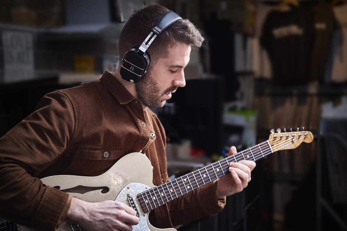 With a transmitter plugged into the guitar and the Waza-Air headphones popped on the noggin, players can noodle away without disturbing other in the home