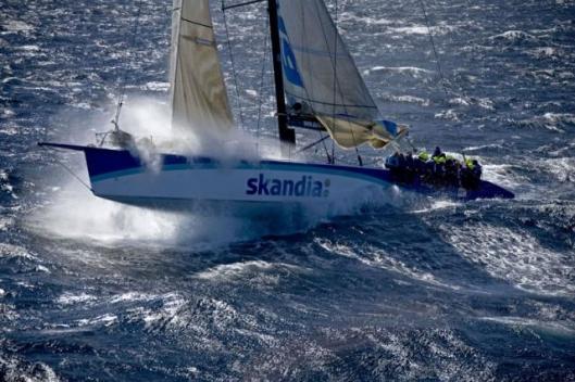 SKANDIA launches off a wave near Tasman Island Photo: Carlo Borlenghi