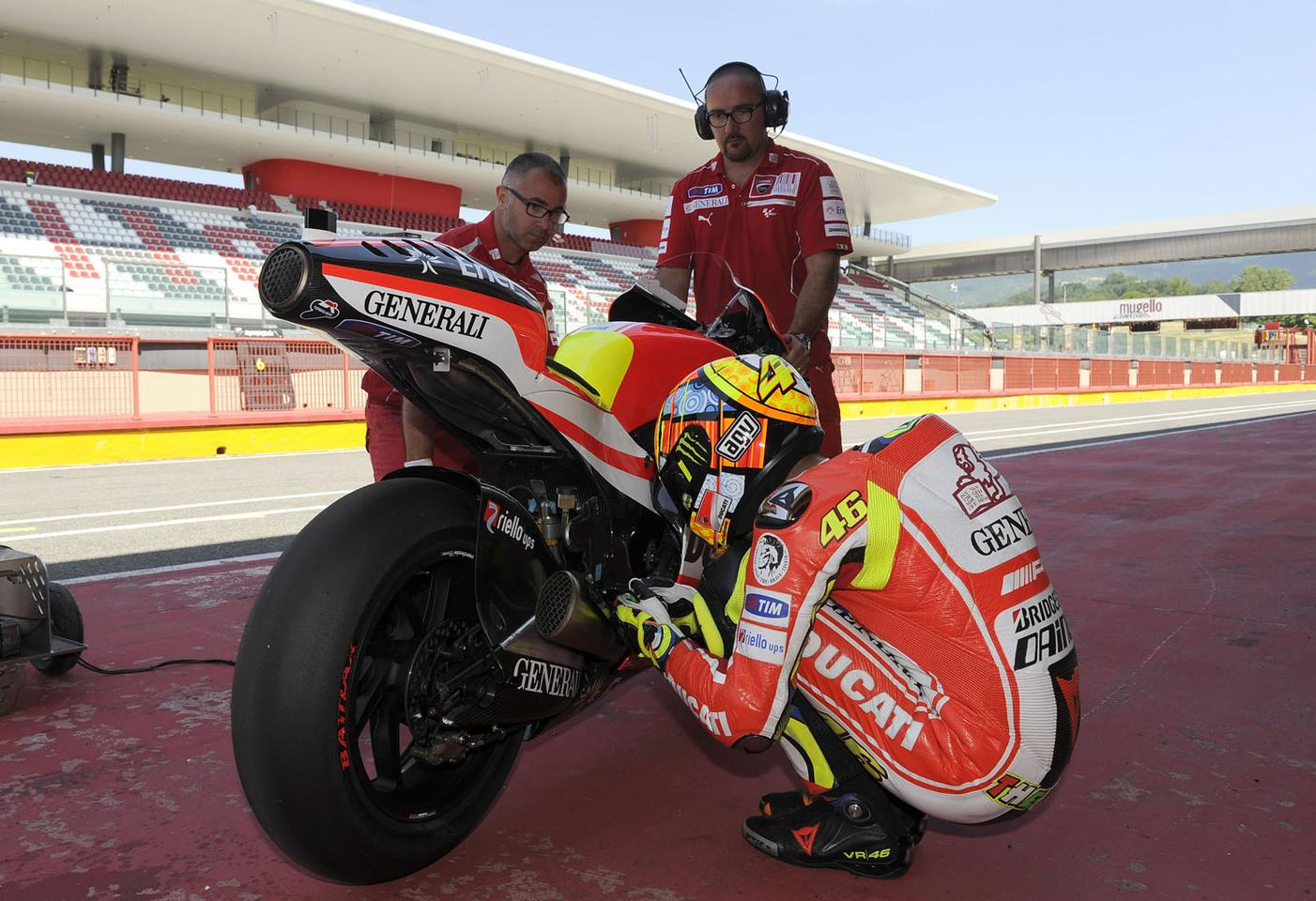 Rossi says a little prayer - is he asking for a traditional chassis?