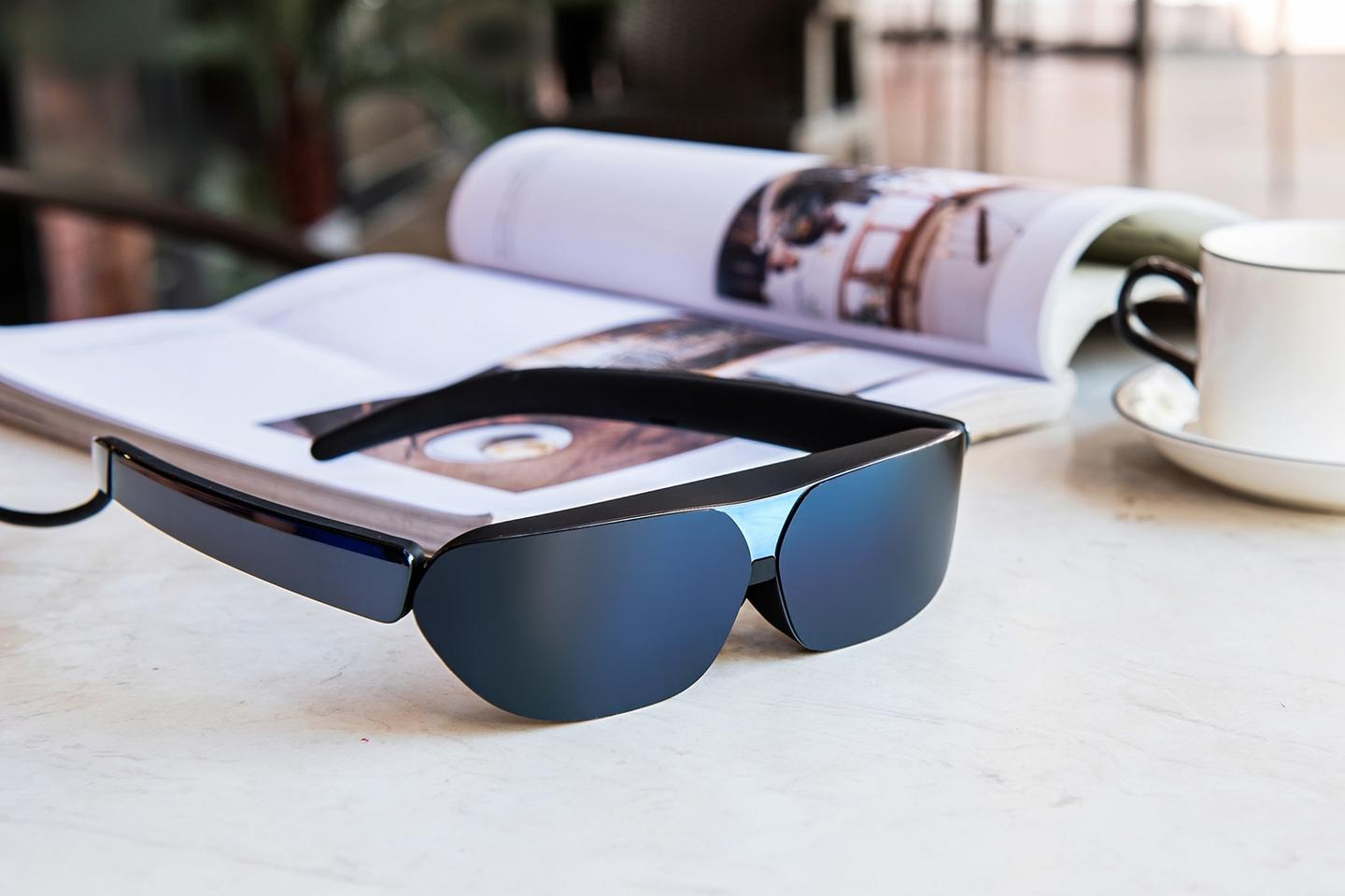 The NXTWEAR G specs are powered by a phone, tablet, or laptop
