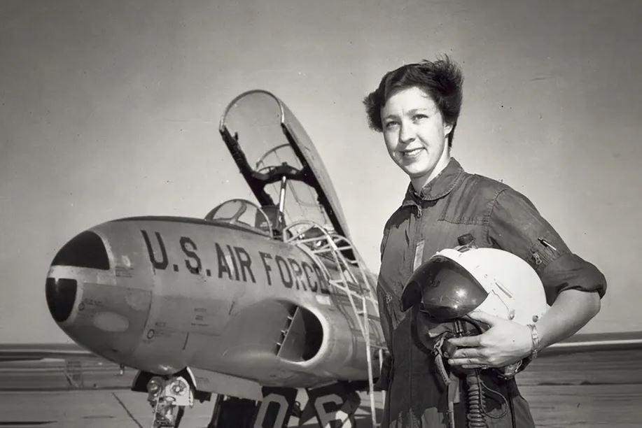 A young Wally Funk next to a Lockheed F-94 Starfire