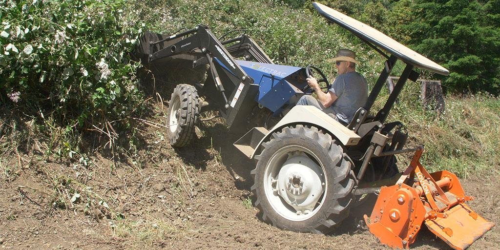 The eUtility Electric Tractor, seen here with its front loader