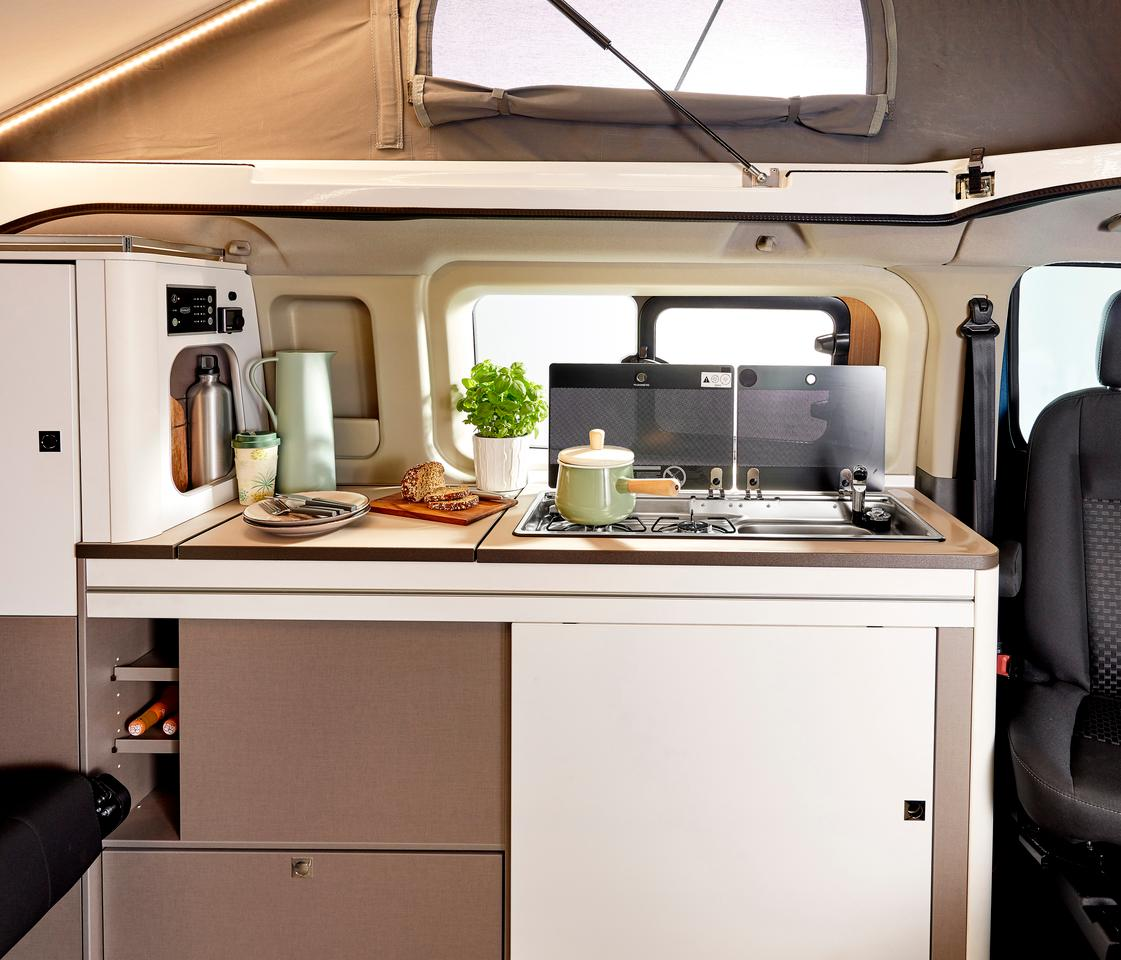 The Burstner Copa kitchen block comes standard with a dual-burner stove and sink, and the 41-L compressor fridge box is optional and included with several packages