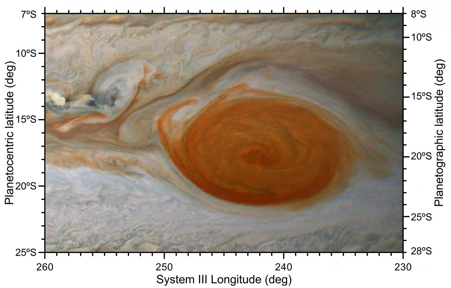 Image of the Great Red Spot taken using Juno's JunoCam instrument, showing flakes of red clouds being torn away from the planet-sized storm