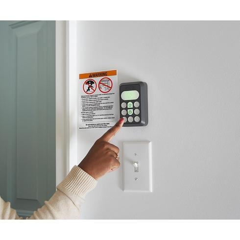 The Ryomi door opener includes a wireless keypad and controller