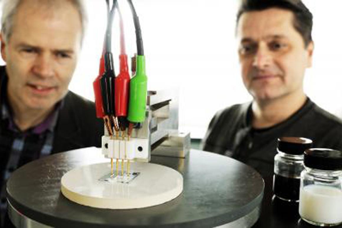 Professors Cor Koning (left) and Paul van der Schoot (right), with their new transparent conducting film (Image: Bart van Overbeeke)