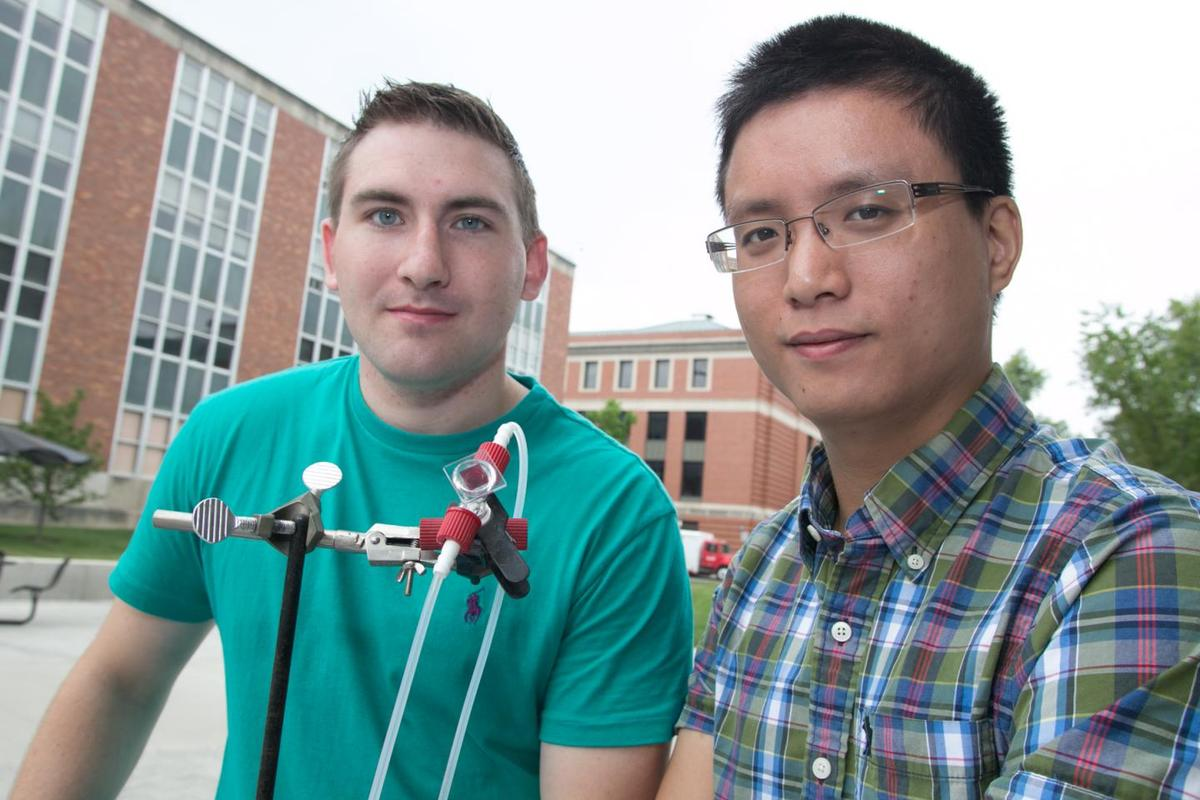 The Ohio State University researchers with the prototype device they call the first aqueous solar flow battery