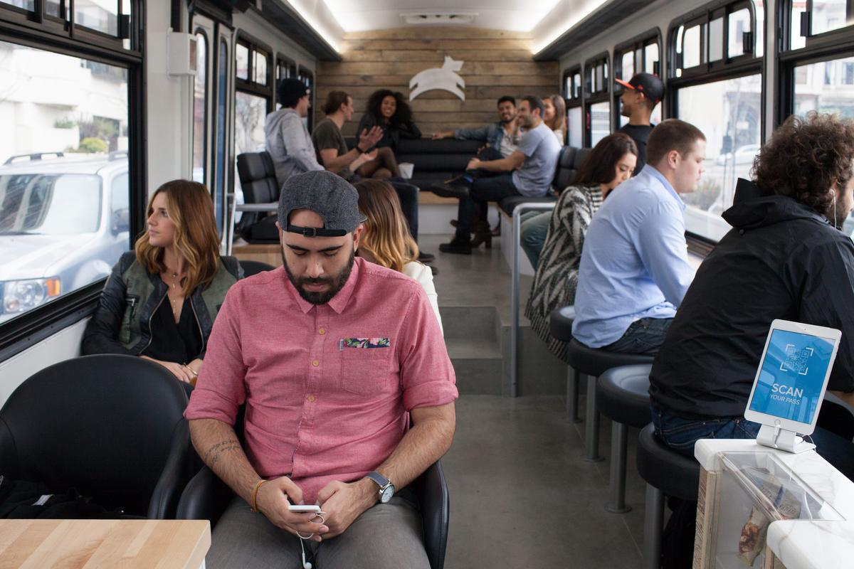 Inside the big blue city bus, commuters are offered a choice of three seating areas