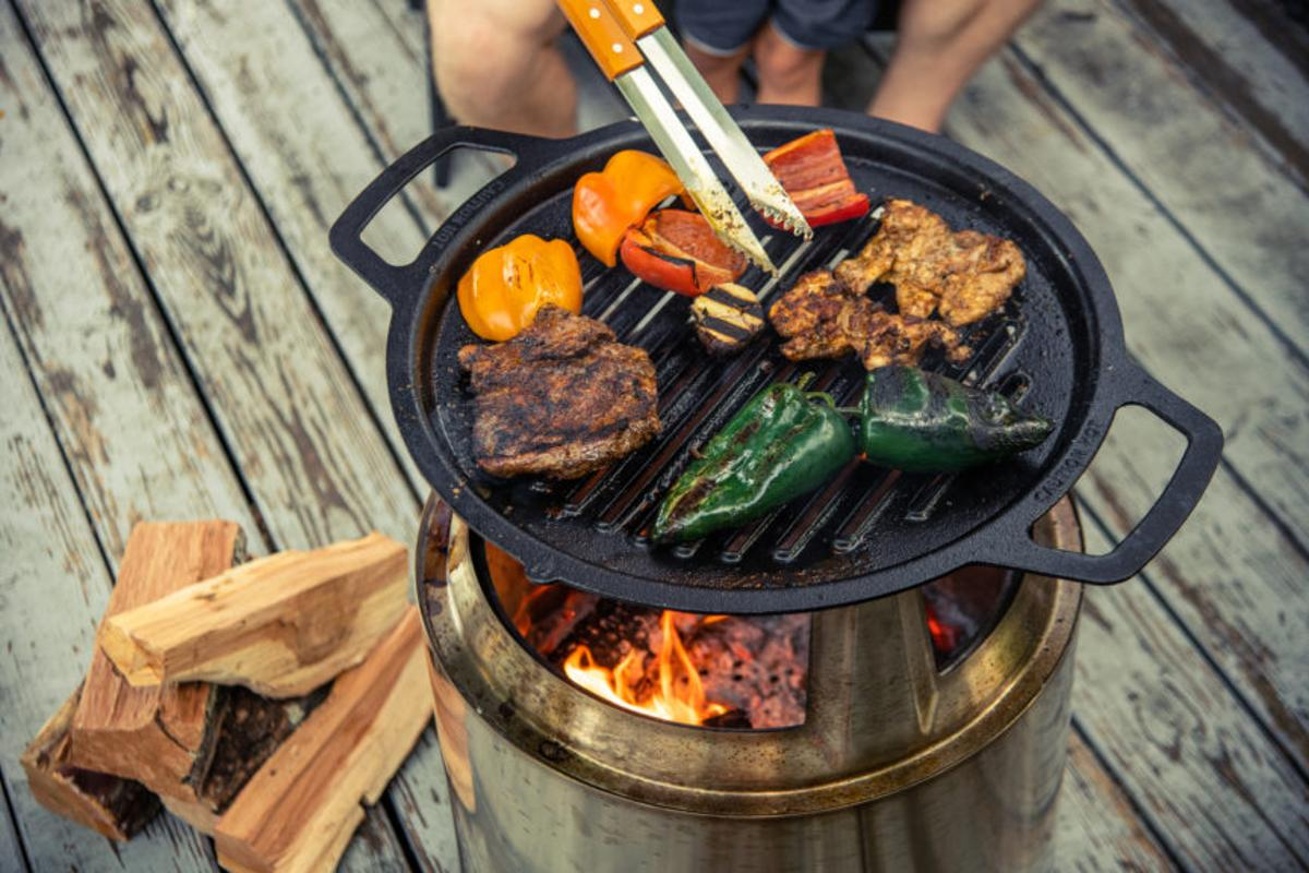 Solo Stove's Fire Pit Cooking system is available in three sizes to suit its existing fire pits