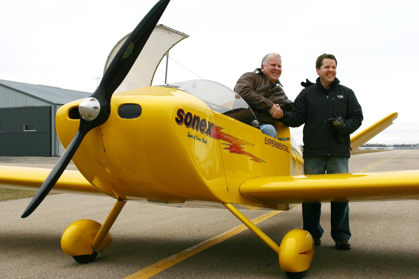John Monnett (left) and Jeremy Monnett (right) celebrate the successful maiden flight