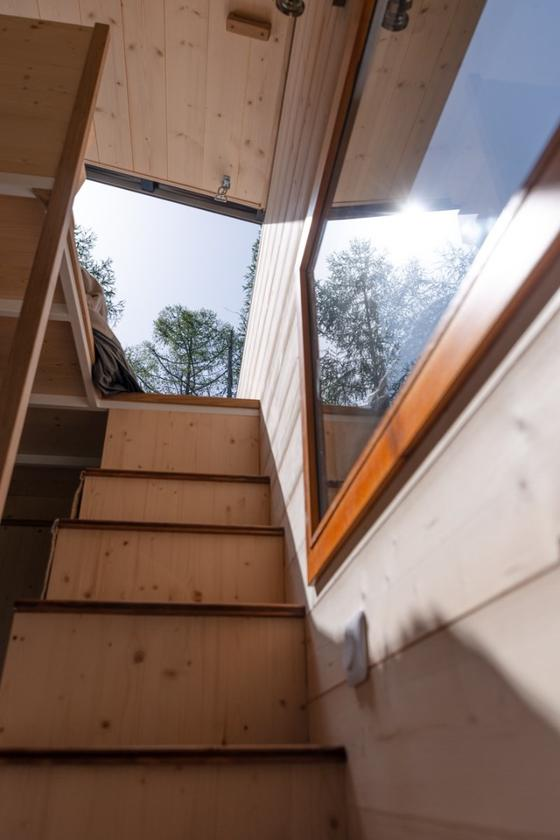 Storage-integrated staircase leads up to theTiny House Franck's bedroom