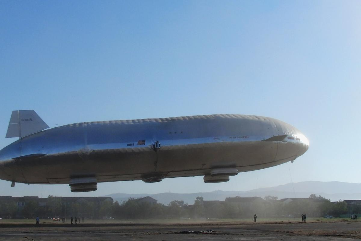 Still attached to tethers, the Aeroscraft prototype lifts a short way into the sky as pre-flight testing continues on the ground-breaking airship (Photo: Aeros)