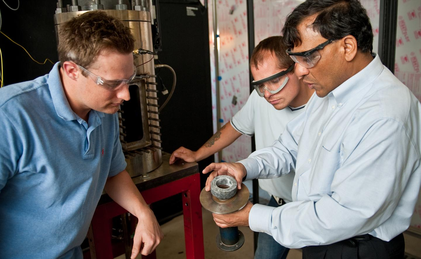 Dr. Ajay Agrawal, right, with graduate students Justin Williams, left, and Joseph Meadows, center, examine the noise reduction device, or noise sponge (Photo: Zach Riggins, University of Alabama)