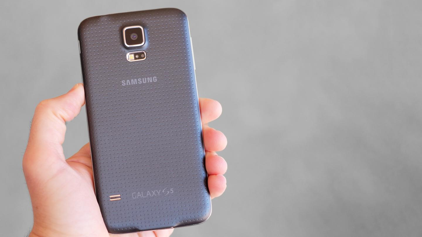The Galaxy S5 has a dimpled faux leather finish on its back
