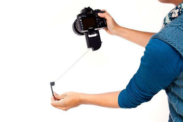 The SteadePod is a camera-stabilizing device, that holds the camera steady using upward tension on a retractable cable (Photo: Photojojo)