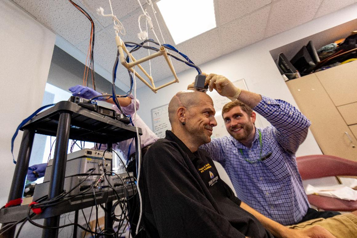 Spinal cord injury patient Buz Chmielewsk with Johns Hopkins University researcher Matt Fifer