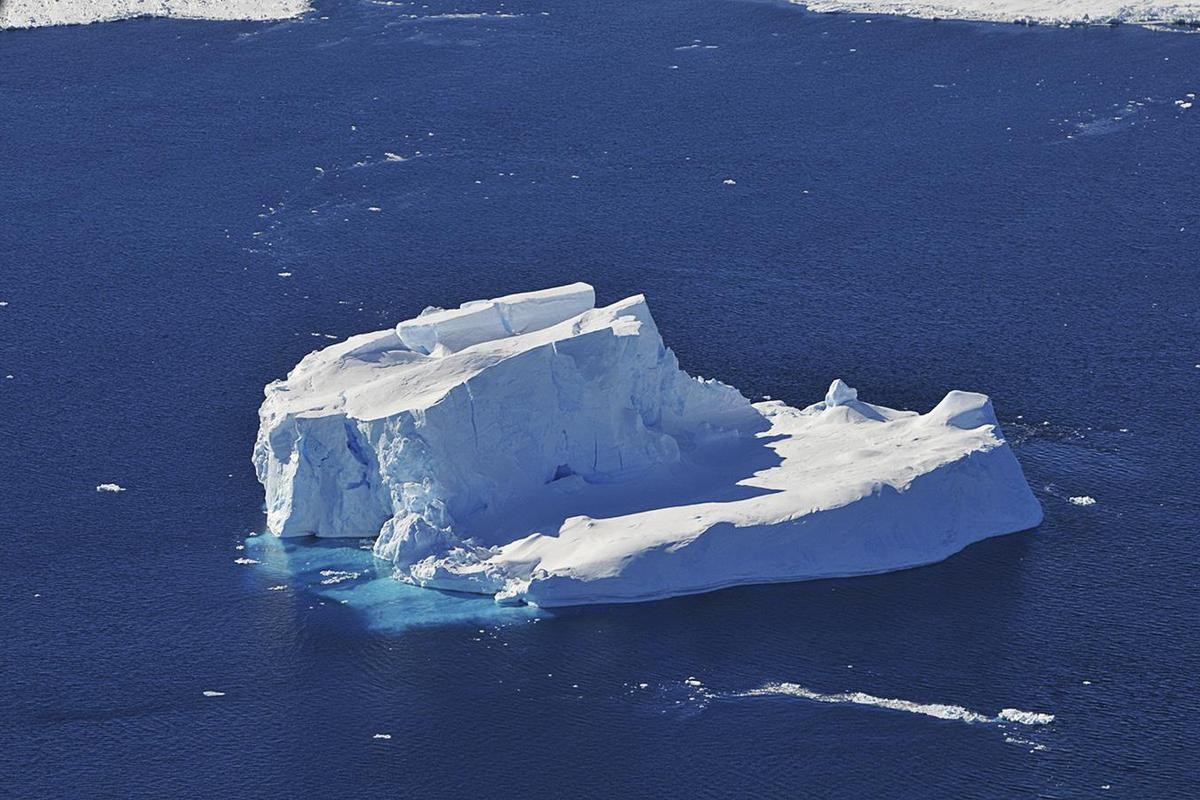 A huge iceberg seen from the window of a NASA research plane off the coast of West Antarctica