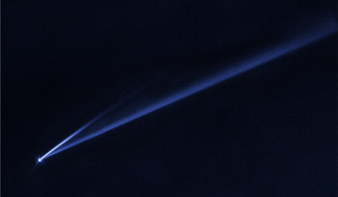 A Hubble Space Telescope image revealing the gradual self-destruction of an asteroid, whose ejected dusty material has formed two long, thin, comet-like tails