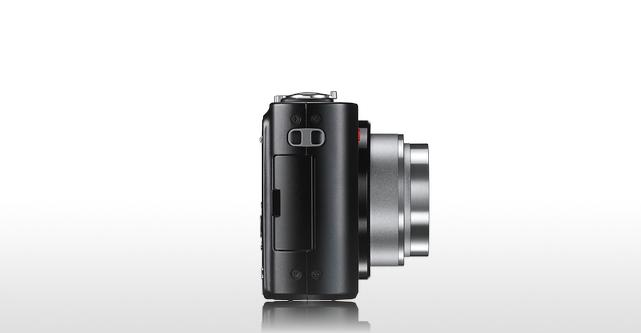 View from the side showing the memory card compartment and lens