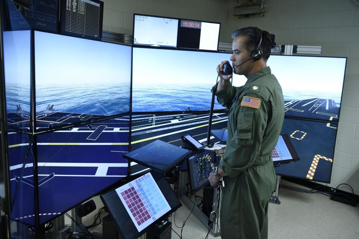 Commander Jason Cassisi, air boss aboard the aircraft carrier USS George H.W. Bush (CVN 77) participates in a final prototype demonstration of the Office of Naval Research (ONR) TechSolutions-sponsored Flight Deck Crew Refresher Training Expansion Packs (TEP)