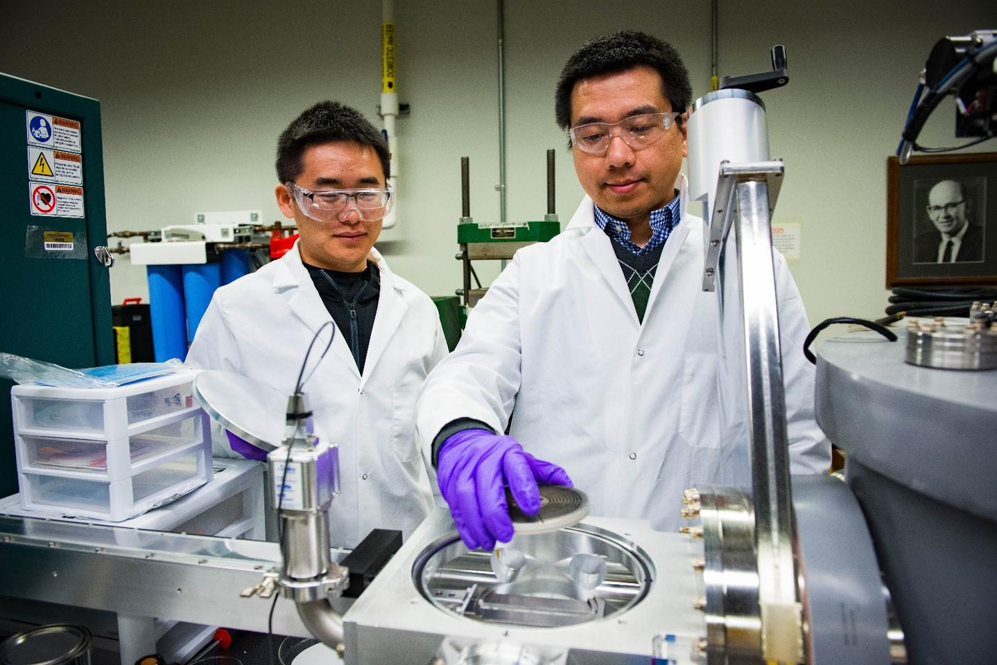 Two researchers on the project, (left)Sichuang Xueand Qiang Li, prepare a sample for study