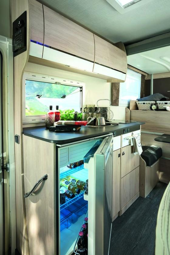 The Flash 634 includes a kitchen area with two-burner stove, sink and 146-L refrigerator
