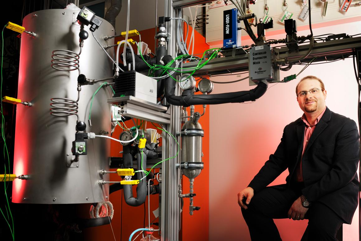Dr. Mohamed Halabi, with his lab setup for performing sorption enhanced catalytic reforming of methane (Photo: Bart van Overbeeke)