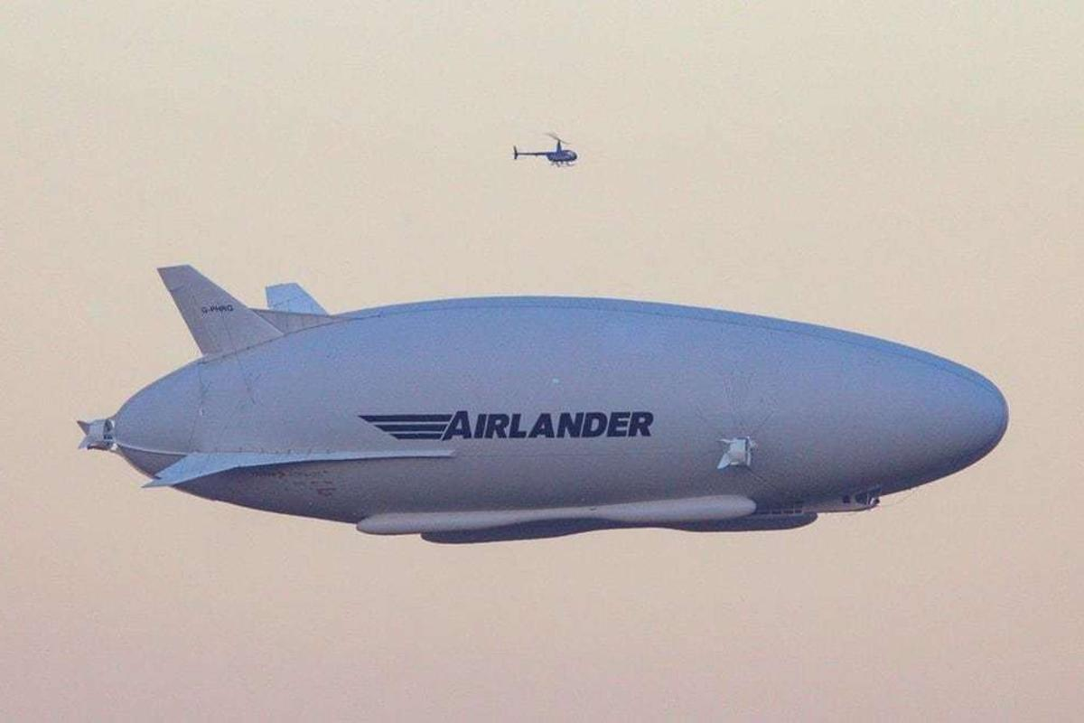 The Airlander 10 airship, seen here on its maiden flight with a helicopter escort