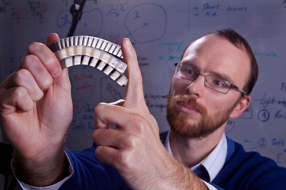 Assistant Professor Stephan Rudykh with a sample of the material (Photo: Technion-Israel Institute of Technology)