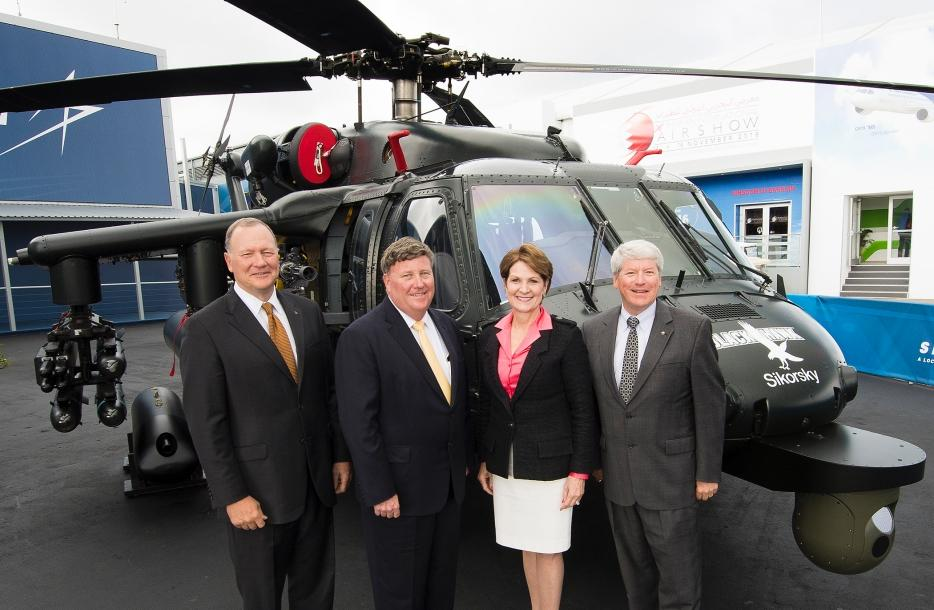 The Sikorsky Black Hawk was on display at the show, with smiling executives in tow