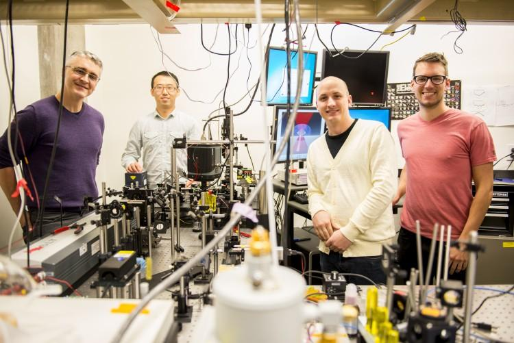 This instrument built by UW engineers (from left) Peter Pauzauskie, Xuezhe Zhou, Bennett Smith, Matthew Crane and Paden Roder (unpictured) used infrared laser light to refrigerate liquids for the first time