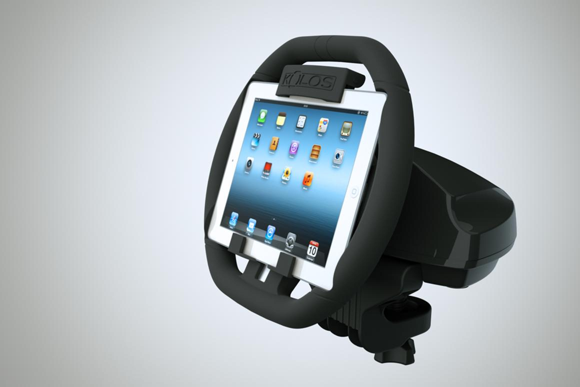The KOLOS attaches to an iPad and turns it into a steering wheel for racing games, complete with a detachable base that attaches to most surfaces