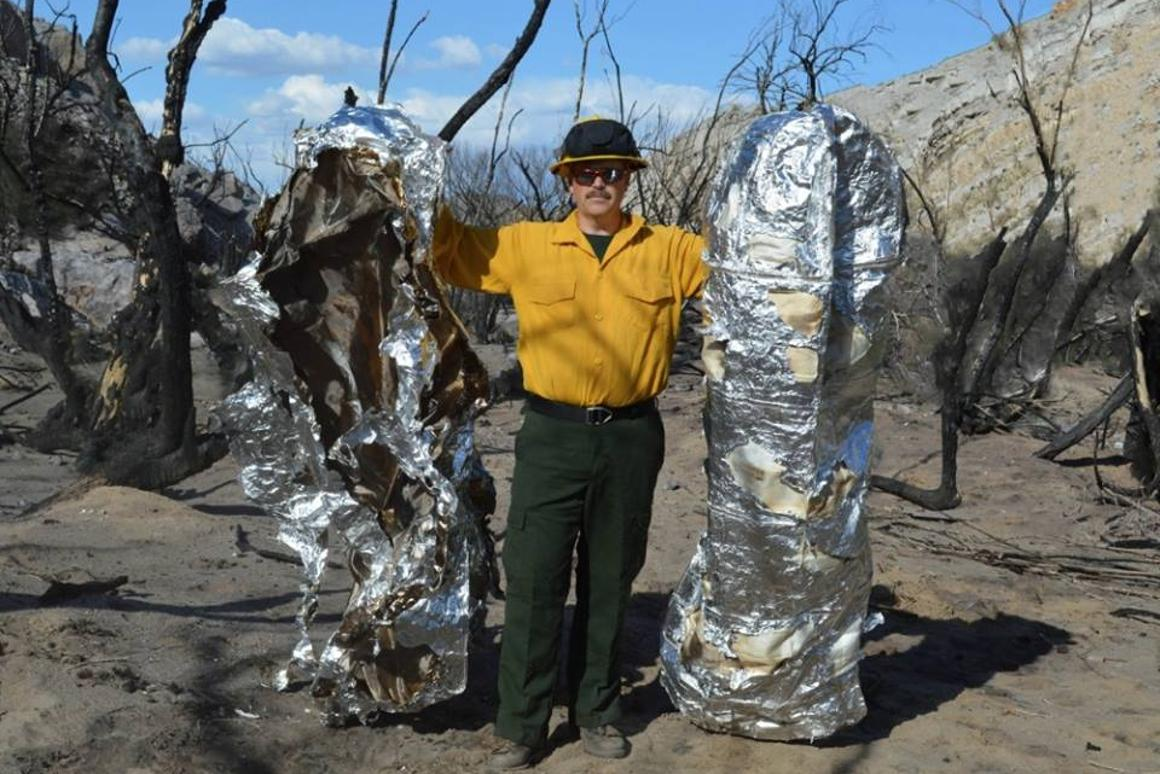 A conventional fire shelter after exposure to the heat of a forest fire (left) as compared to the Fire Blanket