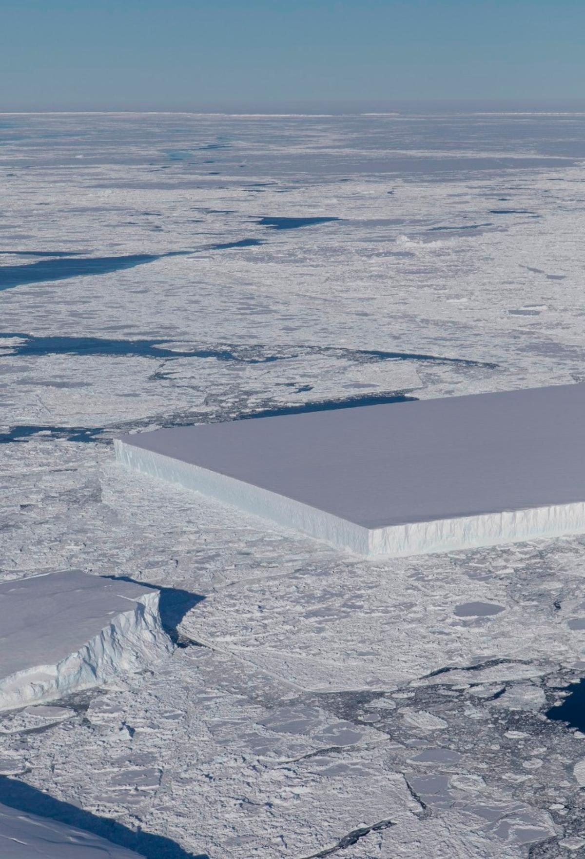 This bizarrely, but not unusual,rectangular iceberg is called a tabular iceberg and was discovered by IceBridge just a few days ago floating off the Larsen C ice shelf