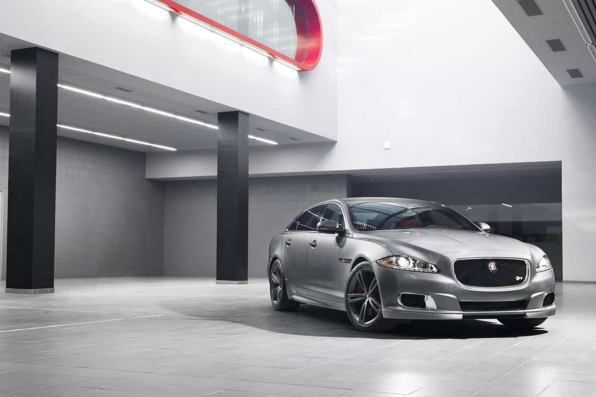 Lowered suspension and low profile 265/35 and 295/30 Pirelli rubbers fill out the Jag's muscular wheel arches nicely
