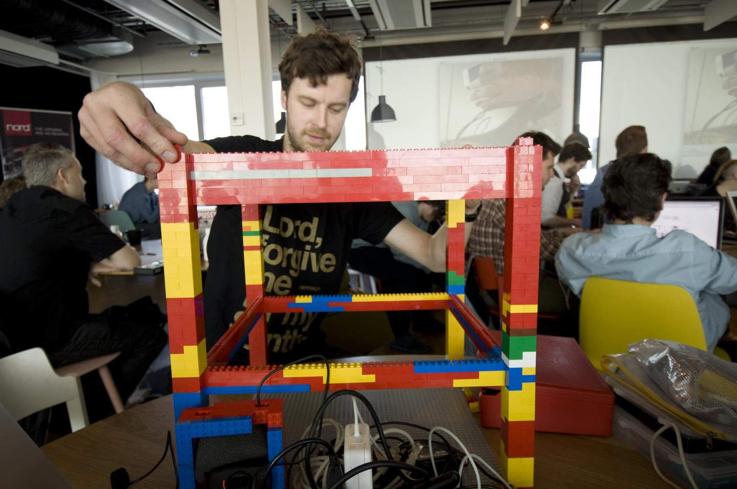 The upper surface measures 54 x 54 Lego brick studs, and the structure rises some 50 cm (20 in) from the ground or desk on which it sits