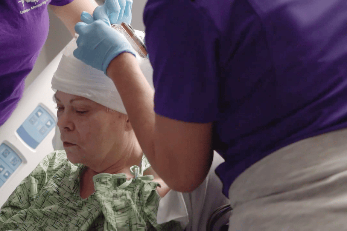 A patient is fitted with a memory-enhancing brain implant