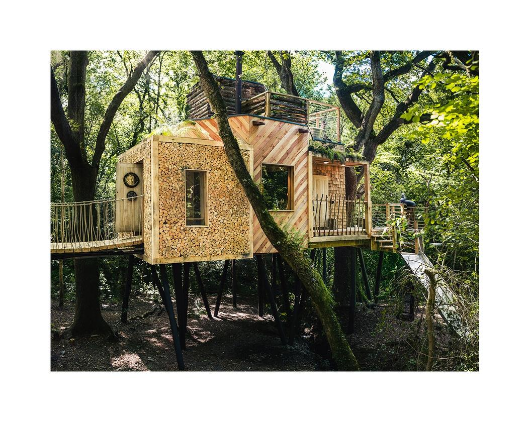 The slide can be seen to the right, there's a hot tub on the roof and access to the Woodsman's Treehouse is gained via an oak door with submarine locking system