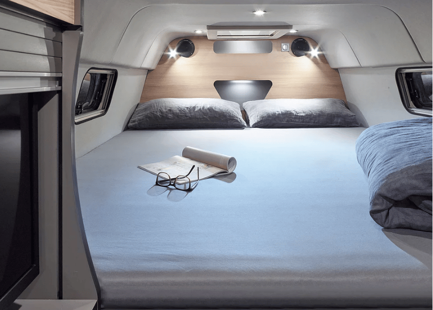 More than just a bed in the rear, the Alphavan's master suite is a cozy sleeping nook closed off from the van with a rear wall