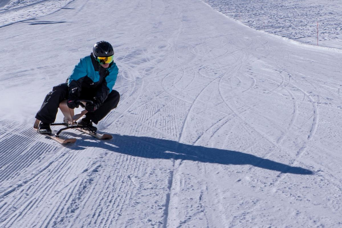 A rider gets on the edge with the Aroc sled