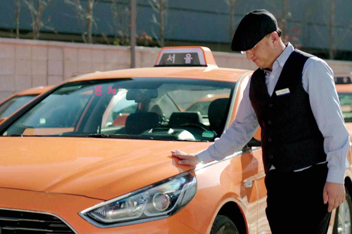 Daeho Lee, a deaf taxi driver in the city of Seoul, utilizes the technology in his cab