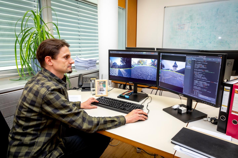 TU Graz researcher David Schinagl, analyzing three shoes-eye-view shots from the cameras