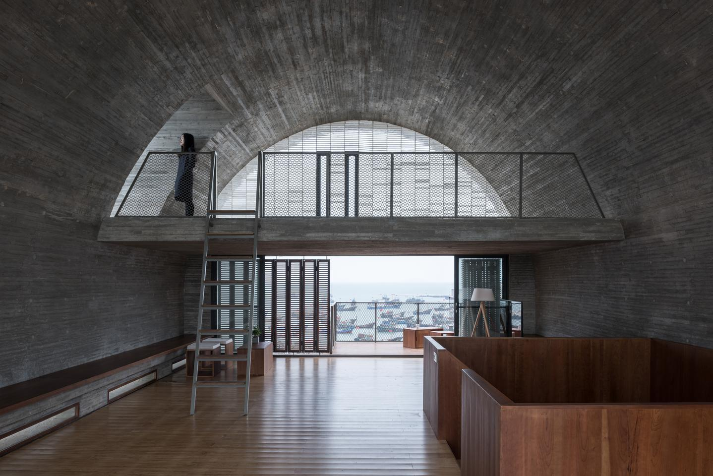 Renovation of the Captain's House was designed by Vector Architects and is located in China. The project involved the refurbishment and extension of an existing ship's captain's house poised on the water's edge overlooking the East China Sea. It's defined by a distinctive barrel-vaulted roof
