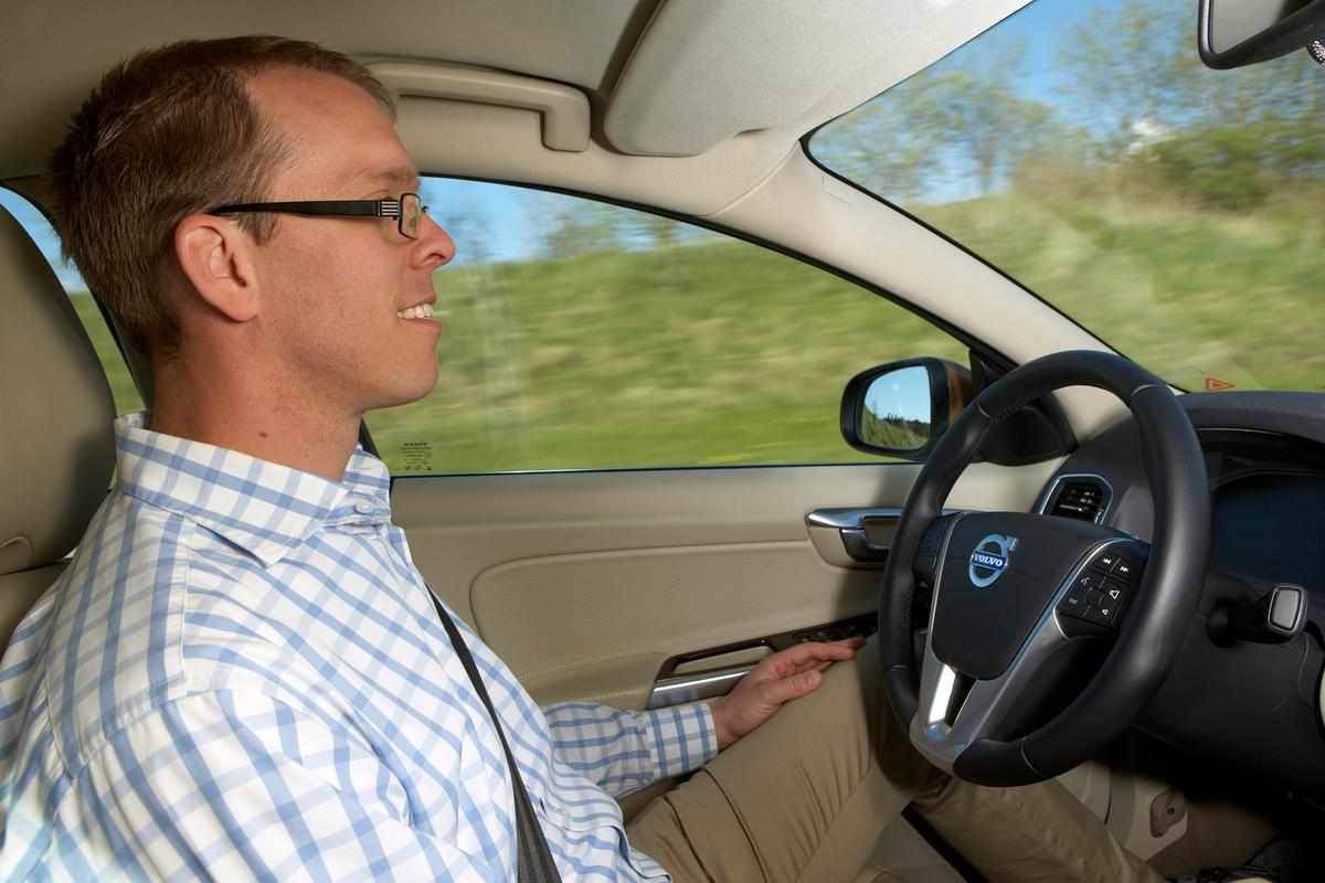 Andreas Ekenberg, Function Developer Autonomous Driving Support, behind the wheel of the Volvo test car