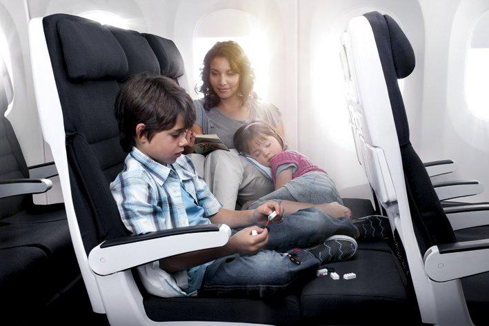 The Air New Zealand Sky Couch converts seat leg-rests into a lying space (Credit: Air New Zealand)