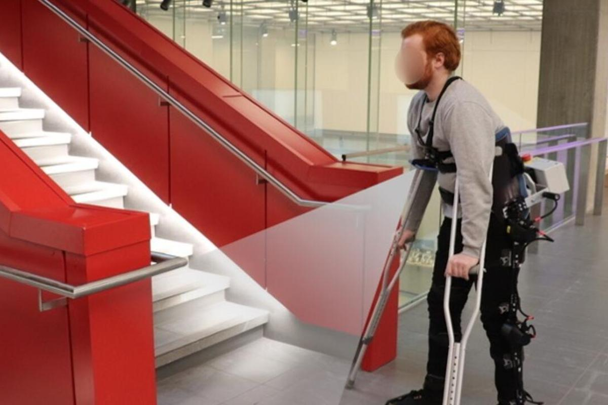 A camera-wearing test subject approaches a staircase